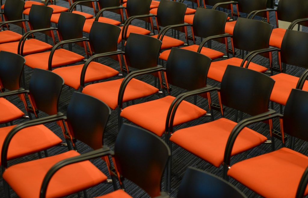 Rows of chairs with red seats